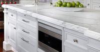 O'Brien Harris: Amazing white kitchen with endless kitchen island with built-in microwave nook, small ...