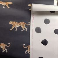 This black panthera wallpaper would be so dreamy in my midcentury black-and-white tiled bathroom.