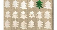 Gold Christmas trees painted on a burlap covered canvas