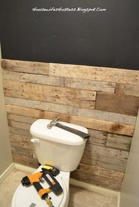 Bathroom Accent Wall- done here in pallett wood.