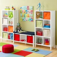 This would fit perfectly around the big window in the boys' room! Bookcase and bench for their playroom, The Land of Nod.