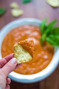 A 5 minute dip that is packed with flavor! This roasted red pepper dip is vibrant, healthy and a always hit at parties.