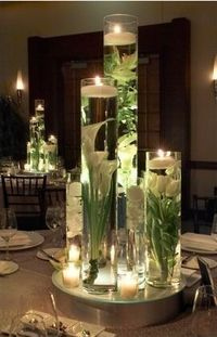 Glue fake flowers to the bottom of a tall vase (or to stones you could drop in), fill with water, and top with a floating candle. Gorgeous and you could use any color to fit the room you put it in for the bbw vases on my fireplace.
