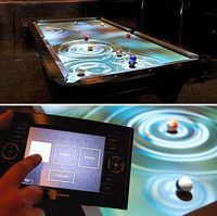 CueLight is an augmented reality pool table that uses an HD projector to display digital effects during game play.