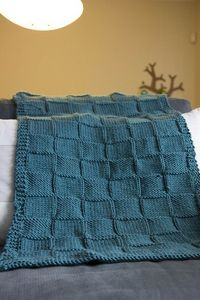 My sister knitted this baby blanket for her friend's daughter. She used Debbie Bliss Baby Cashmerino. It is nice and soft! I taught her how to knit... *pat on t