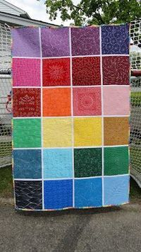 """This is the back of a modern quilt using a variety of Leah Day machine quilting patterns to quilt the individual blocks, which are then sewn together as a """"quilt as you go"""". The blog this is from is fresh, modern and creative."""