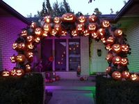 Recently, in a fit of I don't know what, I bought a bunch of plastic jack o'lantern pails for a buck apiece because I was inspired by this:and this:Then I was thinking I would rig them with a string of lights and hang them in my big maple tree out...