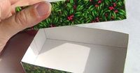 Gift boxes make wrapping most items easier; wrap the item in a few sheets of tissue paper, pop it in a box, slap on the lid, top it with a beautiful curling rib