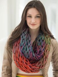 Arm knitl this cowl in your favorite color-changing yarn. This one uses Lion Brand's Unique.