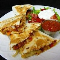"Texas Chicken Quesadillas | ""What a great twist to quesadillas! They were a hit for a football party."""