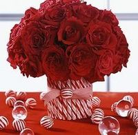 Love this, with crepe paper roses in red and white, maybe tied up with a glittery aqua and lime green bow