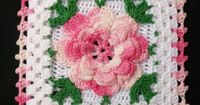 Crochet square pot holder with a pink rose