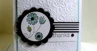 StampinUp card with beautiful embossed panel and a sweet flower inside a scalloped circle die cut...