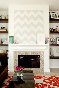 living rooms - white gray canvas chevron herringbone zigzag art mosaic tiles fireplace espresso chunky floating shelves ivory red floral rug glossy black lacquer rectangular coffee table