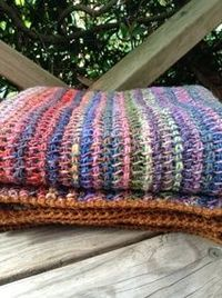 "I finished this recently and wanted to share: It's made using Jennifer Hansen's Tunisian Stash Buster pattern, but I used a sock yarn �€"" Noro Silk Garden Sock �€"""