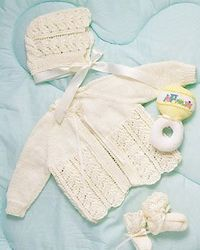 This baby layette knitting pattern creates a matching set of delicate baby jacket and baby bonnet. The baby bonnet and jacket are tied with sweet satin ribbon.