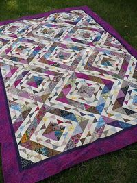 """This quilt started from an exchange of """"ugly fabric"""" strips (2.5 and 4.5 inches). The challenge was that we could not eliminate any fabrics when making the quil"""