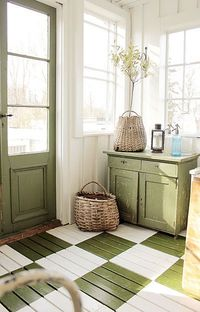 amazing light in this room ! I love the greens ..... door, cabinet & floor