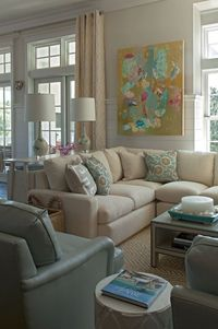 Collins Interiors - living rooms - chic living room, tongue and groove walls, tan walls, abstract art, blue chairs, blue armchairs, blue lea...