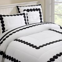 "Because they're just ""Dots"", not ""Polka Dots"", this isn't girly at all. Rare to find gender neutral bedding. You can always add color with the sheets and more pillows. Even better, it just went on sale!"