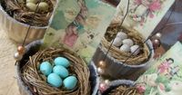 Easter or May baskets made from small vintage molds, hobby store nests, vintage card copies, wire & beads. Instead of faux plastic or wooden eggs, use sky-blue candied almonds for eggs (wedding candy - look at Walmart).