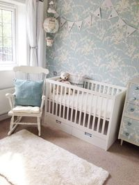 A gender neutral upcycled nursery. The nursery mixes swedish style furniture, mid century revamped retro and hand painted, distressed solid wood pieces.