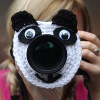 Camera lens buddy. Crochet lens critter panda bear. Photographer helper. $12.99, via Etsy.