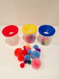 Quick preschool activity - fine motor skills. I have paint cups like this that I am not using. Now I know what to do with them!