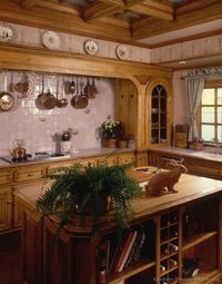Ooh, love the wood surround over the cooking area and the tiled backsplash wall with the pot rack overhead ~ Google Image Result for http://www.kitchen-design-ideas.org/images/kitchen-cabinets-traditional-medium-wood-golden-brown-015a-s259150-island-coffe...