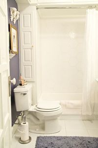 Awesome bath reno - great use of space with built in left of tub and overhead. Love the shower tiles & custom sink.