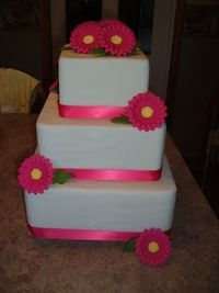 Blue satin ribbon and the orange gerber daisies? I don't want fondant icing though!