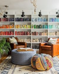 Love the tall color-coordinated shelves