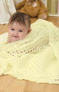 If you're looking for a simple crochet baby blanket to give to a newborn, check out this project for a Crochet Yellow Baby Blanket from Red Heart Yarn. This cra