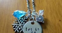 "Disney Frozen Necklace inspired by Elsa. ""Let It Go"" Necklace by WithLoveFromOC, and free shipping. Silver colored with blue and white Swarovski crystal charms and a heart and snowflake charm. This is the perfect Frozen necklace for a gift."