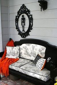 "A previous poster said: ""cheap ornate frame, spray painted with skeleton inside. how cute and cheap! "" But I like the black furniture with the black toile upholstery---that couch is a bed converted to a bench!"