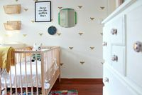 Bee inspired by this beautiful wall of removable bee decals in a lovely girl's nursery