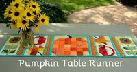 Quilted Pumpkin Table Runner. Pattern from Lori Holt's Farm Girl Vintage book. I was able to practice using rulers in my quilting with this project! - Pink Polka Dot Creations