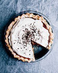"This whipped cream�€""topped banoffee pie gets flavor from dulce de leche, chocolate and bananas. Get the recipe from Food & Wine."