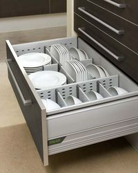 Bottom kitchen drawer featuring different-sized storage compartments for plates and bowls