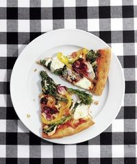 Load up this healthy pizza with broccoli rabe, bell peppers, radicchio, and garlic. Get the recipe for Veggie Pizza.