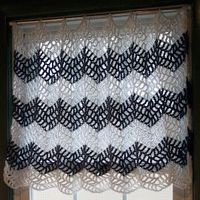 Patterned in a cafe style, these Chevron Crochet Curtains can be worked up and tweaked for your use over any sized window. The crochet curtain pattern has a lac