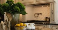 Antique ivory kitchen cabinets with blacK & brown granite countertops and coordinating island paint. What I want!!
