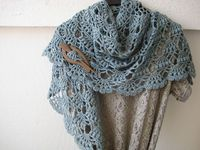 Ravelry: fanalaine's Elegant Shawl Free Pattern.Link not working. Check Lion site for it.