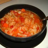 """Cabbage Fat-Burning Soup """"This tomato and cabbage soup was rumored, in days of old, to melt away those thighs."""" - Nell Marsh. I made a pot of this today and it is wonderful! I'm so happy that this diet allows you to eat as much of this as you ..."""