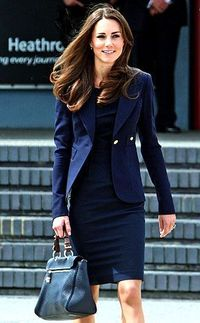 """Boarding a private jet at London's Heathrow airport bound for Ottawa, Ontario, Middleton showed off her super-slim physique in a dark navy Roland Mouret """"Manon"""""""