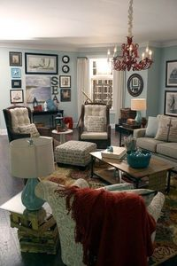 nautical living room - liking the chandelier, and one ottoman two chair layout - not so much those walls.