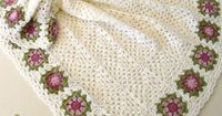 Baby blanket, with white granny squares, and a flower border. The flower border was made with the granny squares from: the �€œSummer Garden Granny Square�€ (from Attic 24). She alternated between the two shades of pink for the pet...