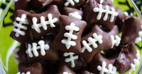 Chocolate Dipped Football Pretzel Bites