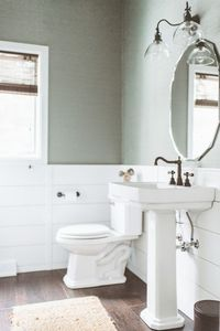 beach style powder room by de[luxe] design studio