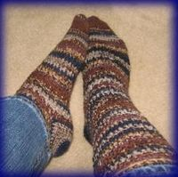 Crochet socks, very easy to make. I don't even need a pattern to do them now but others might appreciate one.